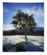 Tree On A Snow Covered Landscape Fleece Blanket