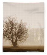 Tree Silhouette In Fog Fleece Blanket