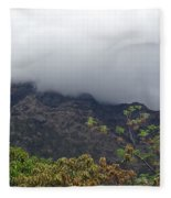 Trees And Leaves At The Base Of A Mountain With Clouds And Mist Covering The Top Fleece Blanket