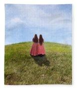 Two Girls In Vintage Dresses Walking Up Grassy Hill Fleece Blanket