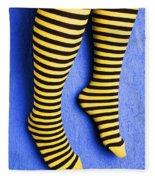 Two Legs Against Blue Wall Fleece Blanket