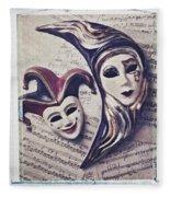 Two Masks On Sheet Music Fleece Blanket