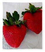 Two Strawberries On A Glass Plate Fleece Blanket
