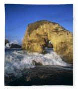 Wave Splashing Against Natural Arch Fleece Blanket