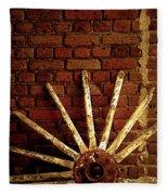 Wheel Against Wall Fleece Blanket