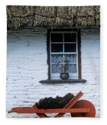 Wheelbarrow In Front Of A Window Of A Fleece Blanket