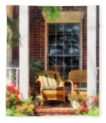 Wicker Chair With Striped Pillow Fleece Blanket