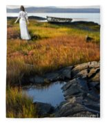Woman By Boat On Grassy Shore Fleece Blanket