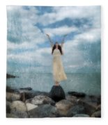 Woman By The Sea With Arms Reaching Up In Praise Fleece Blanket