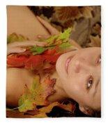 Woman In Fallen Leaves Fleece Blanket
