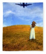 Woman In Field Looking Up At An Airplane Fleece Blanket