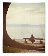 Woman On The Shore Of A Lake Fleece Blanket