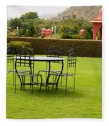 Wrought Metal Chairs Around A Table In A Lawn Fleece Blanket