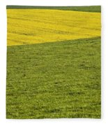 Yellow Rapeseed Growing Amongst Green Fleece Blanket