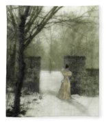 Young Lady By Stone Pillar In Snow Fleece Blanket