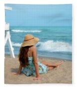 Young Woman Sitting On A Beach Fleece Blanket