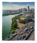 Aerial View Of The Austin Skyline As Rush Hour Traffic Picks Up On I-35 Fleece Blanket