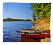 Canoe On Shore Fleece Blanket