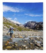 Crossing A River In Patagonia Fleece Blanket