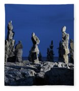 Human Figures Made From Stones At Night Fleece Blanket
