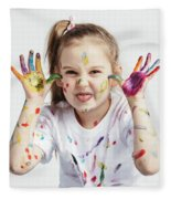 Little Girl Covered In Paint Making Funny Faces. Fleece Blanket