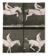 Man And Horse Jumping A Fence Fleece Blanket