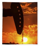 Oil Rig Pump Jack Silhouetted By Setting Sun Fleece Blanket
