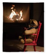 Old Teddy Bear Sitting Front Of The Fireplace In A Cold Night Fleece Blanket