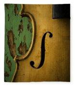 Old Violin Against Green Wall Fleece Blanket