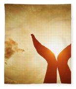 Raised Hands Catching Sun On Sunset Sky. Concept Of Spirituality, Wellbeing, Positive Energy Fleece Blanket