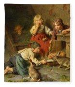 Three Children Feeding Rabbits Fleece Blanket