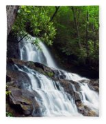 Water Cascading Over Rocky Cliffs Fleece Blanket