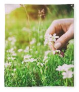 Woman Picking Up Flowers On A Meadow, Hand Close-up. Vintage Light Fleece Blanket