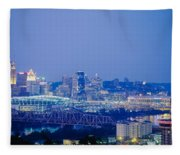 Buildings In A City Lit Up At Dusk Fleece Blanket