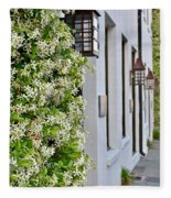 Colonial Home Exterior With Vertical Plants And Old Lanterns Displayed On The Side Of Home Fleece Blanket