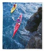 Kayaking Along Coastline Fleece Blanket