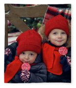 Two Children Sitting On A Bench With Candy Fleece Blanket