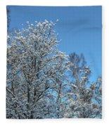 Snowy Trees Against A Blue Sky Fleece Blanket