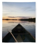 A Boat And Paddle On A Tranquil Lake Fleece Blanket
