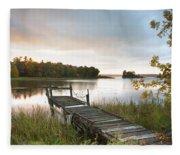 A Dock On A Lake At Sunrise Near Wawa Fleece Blanket