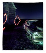 A Light Painted Scene Of A Rusty Caddy By A Barn And Cornfield Fleece Blanket
