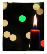A Red Christmas Candle With Blurred Lights Fleece Blanket