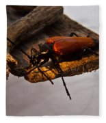 A Red Glowing Beetle Fleece Blanket