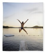 A Swimmer Jumps Off A Diving Board Fleece Blanket