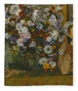 A Woman Seated Beside A Vase Of Flowers Fleece Blanket