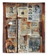 A Wooden Frame Full Of Wanted Posters Fleece Blanket