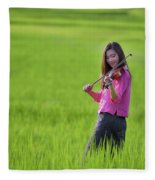 A Young Girl In A Folk Costume Plays A Vivaro In A Green Rice Fi Fleece Blanket
