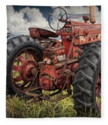 Abandoned Old Farmall Tractor In A Grassy Field Fleece Blanket