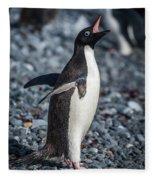 Adelie Penguin Squawking On Grey Shingle Beach Fleece Blanket
