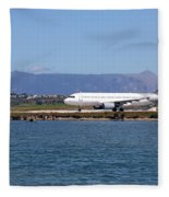 airplane on airport Corfu island Greece Fleece Blanket